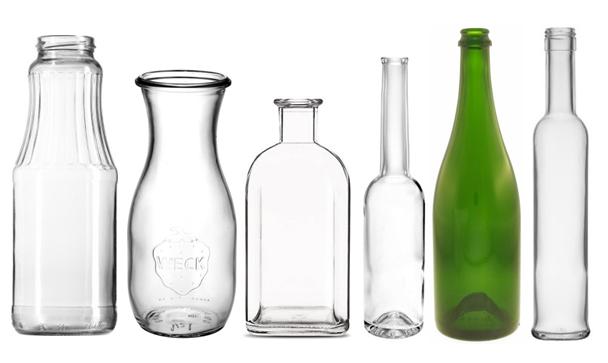 små glasflasker med skruelåg